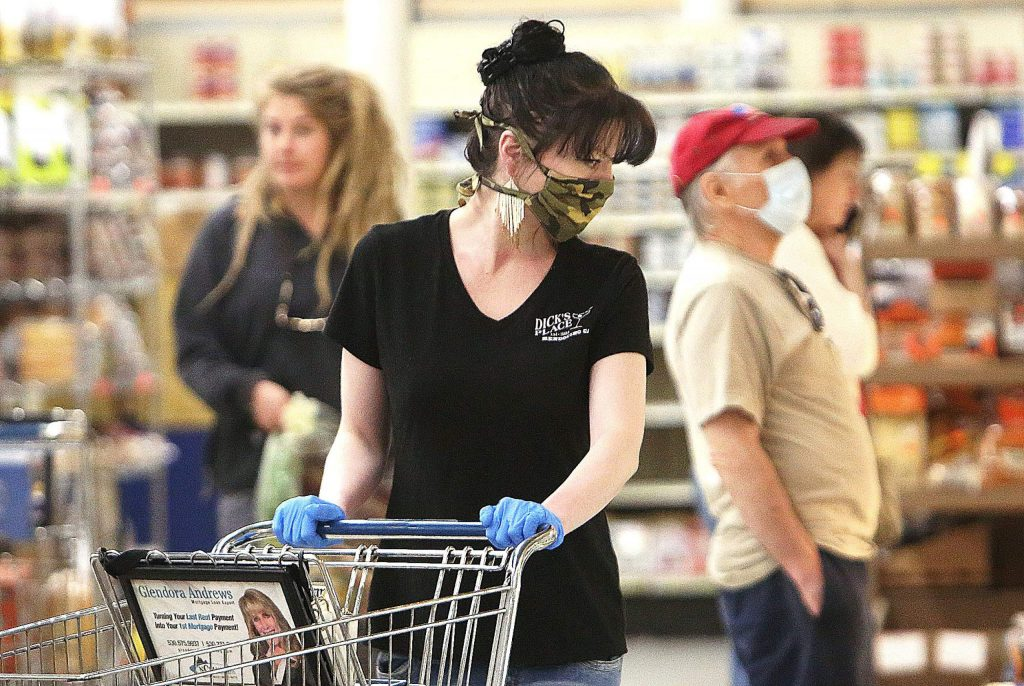 Shoppers at SPD in Nevada City wear face coverings while shopping at the store last week.