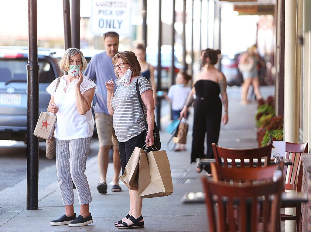 The majority of folks seen walking on the streets of downtown Grass Valley and Nevada City either wore their masks, or kept them handy for when going into businesses Thursday afternoon.