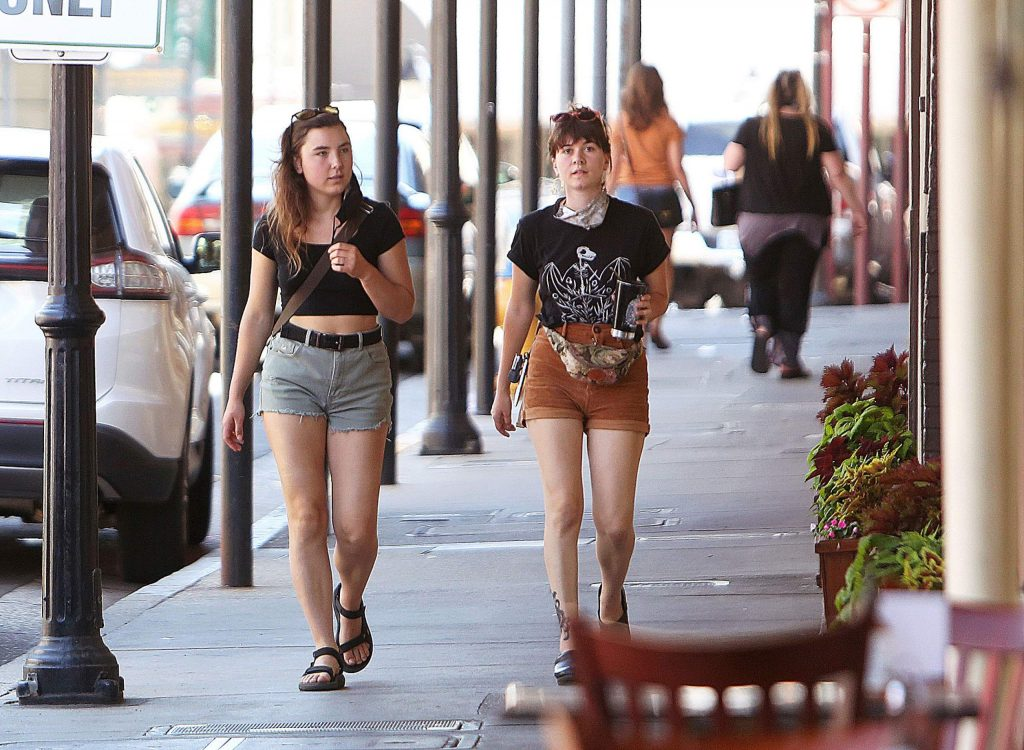 A couple of shoppers walk along Mill Street unmasked but were quick to put them on when walking into businesses.