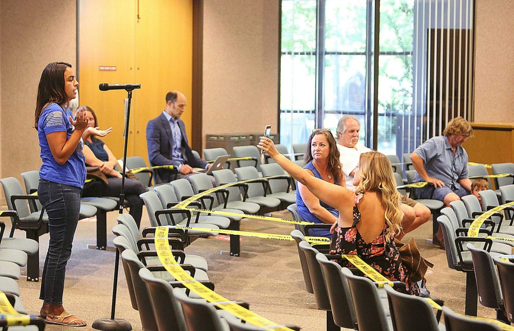 One by one members of the community come up to the microphone to speak during the public comment period at the beginning of Tuesday's Nevada County Board of Supervisors meeting. Most in attendance chose not to wear face coverings and complained about having to use them.
