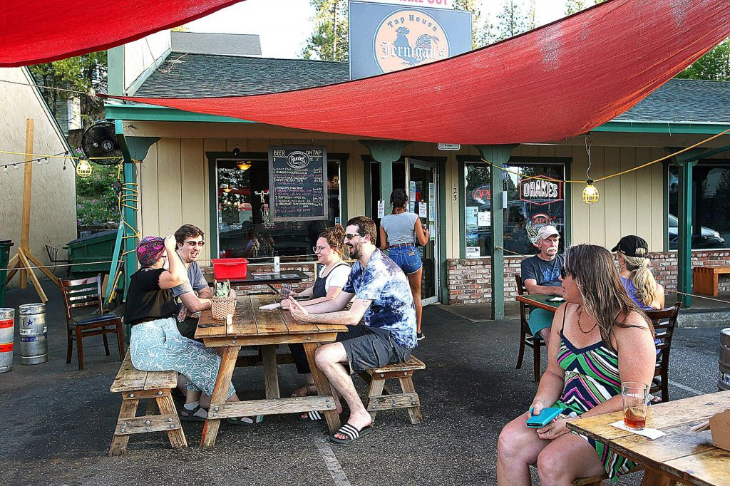 Customers at Jernigan's Tap House & Grill in Nevada City take full advantage of their new outdoor dining section set up in front of their Argall Way business Saturday evening. Diners across the city are welcoming outdoor patio dining options to aid in social distancing and help to ease the mind of patrons.