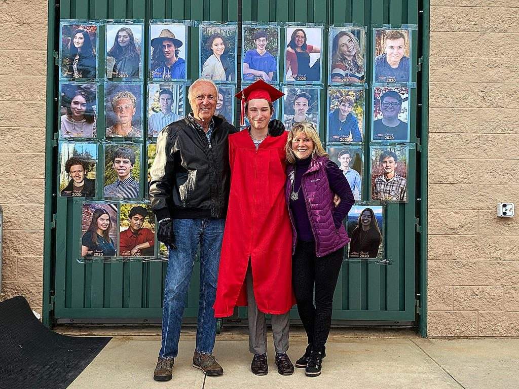 Phil Ruble, Lukas kleinhans and Mimi Simmons in front of the Drive Thru Photo Op Senior Honor Wall at Ghidotti Early College High School Graduation at Sierra College.