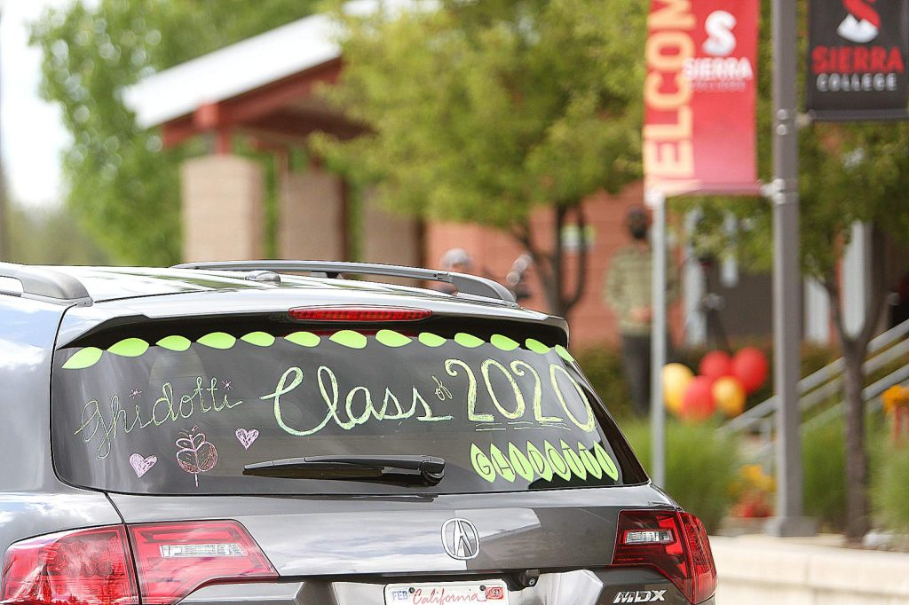 Vehicles containing graduates are decorated as they pass through Ghidotti's drive-thru graduation ceremony last month at Sierra College in Grass Valley.