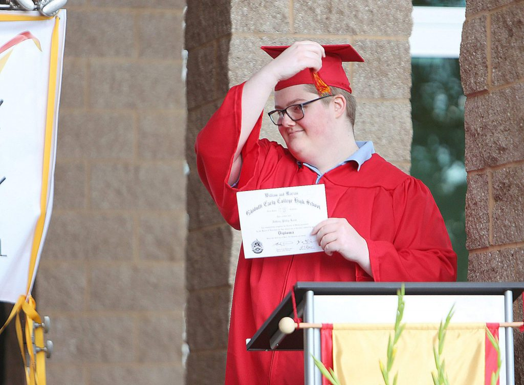 Ghidotti Early College High School graduate Anthony Lerch moves his tassel from one side of the cap to the other signifying his promotion.