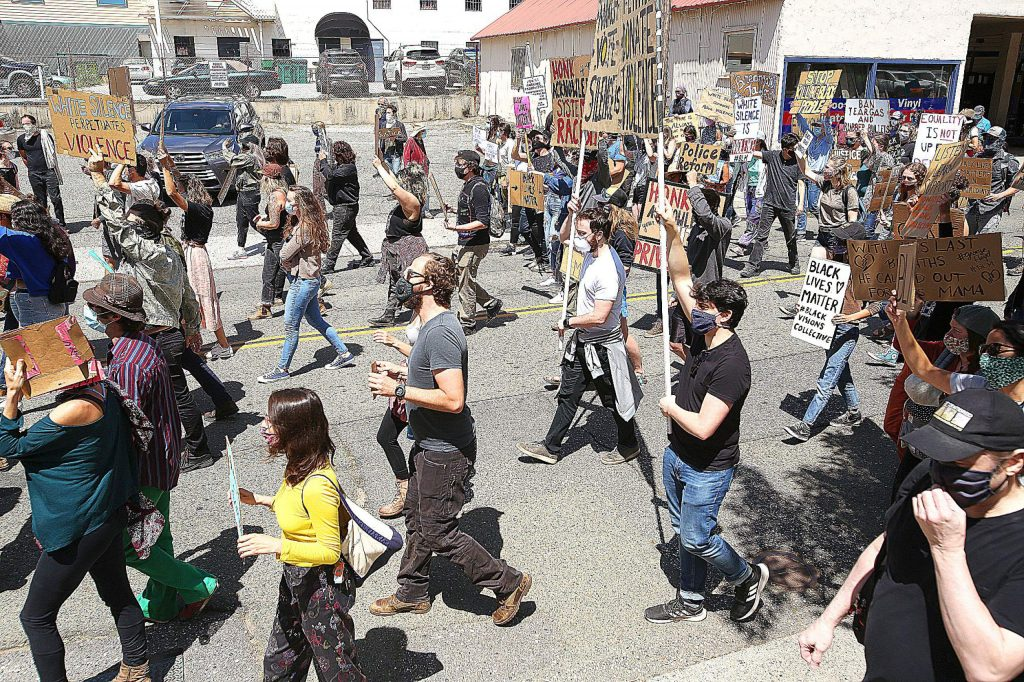 Peaceful protesters begin marching along South Auburn Street Saturday morning in downtown Grass Valley as nationwide police reform protests continue to happen.