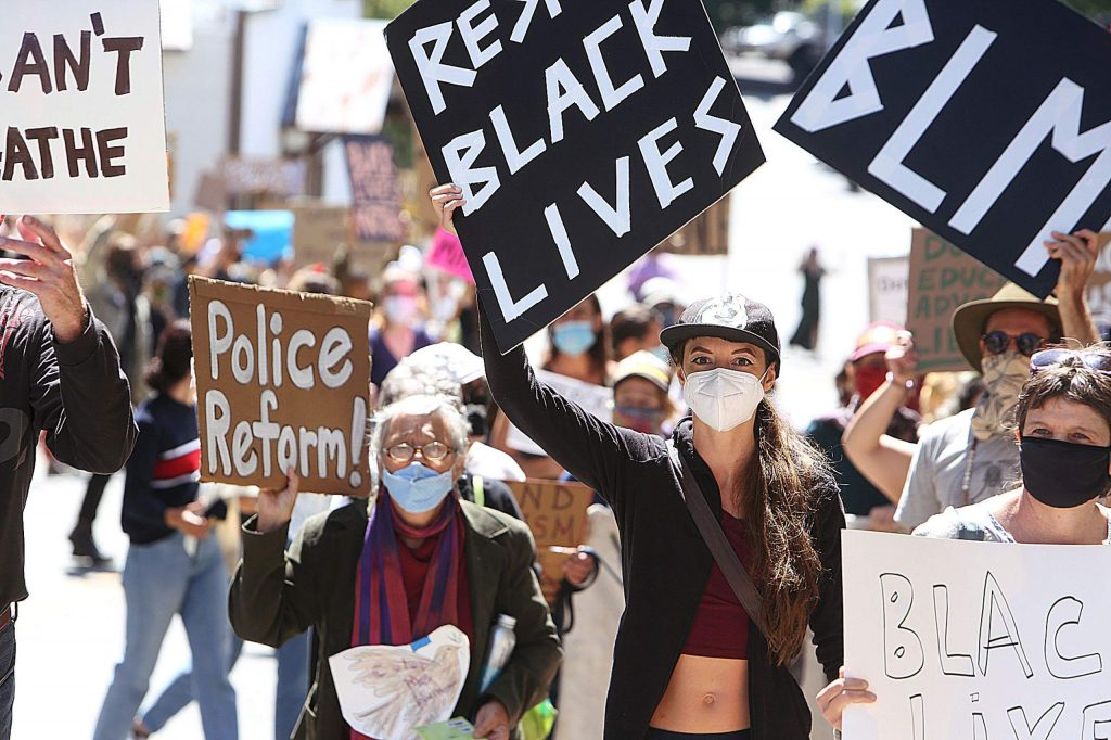 Hundreds of people held signs and marched through the streets of downtown Grass Valley Saturday demanding police reform.