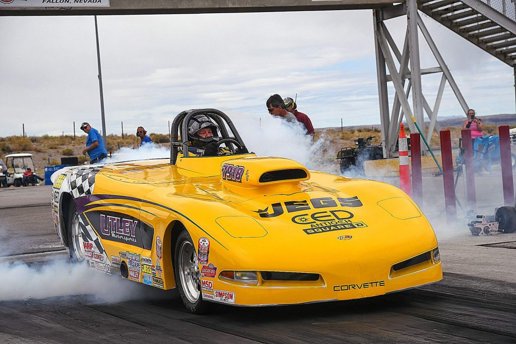 Mike Utley in his 2002 Spitzer chassis, Corvette replica roadster with a 550-cubic inch all-aluminum motor at a race in Fallon, Nevada.