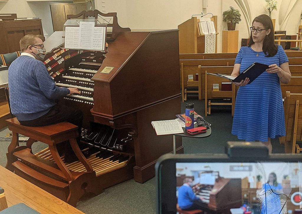Keyboard artist Walt Strony and vocalist Anne Vaaler practice a song they will record for Peace Lutheran Church's online worship experience, available at www.PeaceLutheranGV.org.