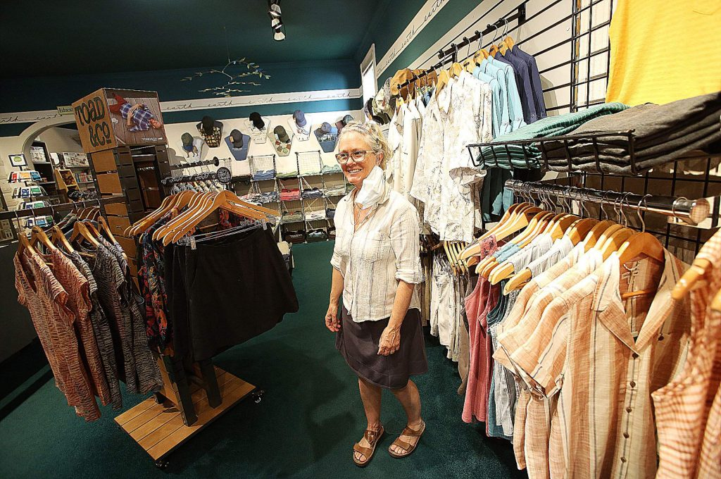 The Earth Store's Leea Davis stands amid a selection of new threads designed for the outdoor enthusiast and now available for purchase at her downtown Nevada City store.