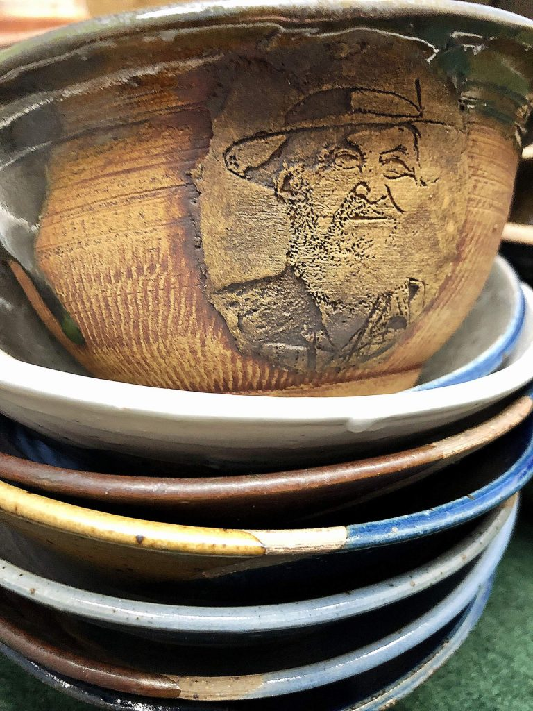 Local artist makes bowl of Hospitality House founder Utah Phillips for Empty Bowl benefit 2020.