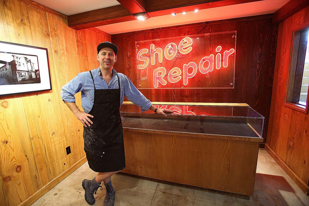 OxVolk LeatherWerks & Shoe Repair's Jacob McDonald in his newly remodeled digs at 102 1/2 Mill St. in downtown Grass Valley.