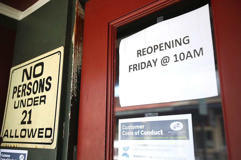 A sign on the door at the Nevada Club in downtown Grass Valley states that they will be reopening at 10 a.m. today. While many drinking establishments have been able to remain open with their food menus, bars such as the Nevada Club have remained closed since the coronavirus shutdowns were implemented mid-March.