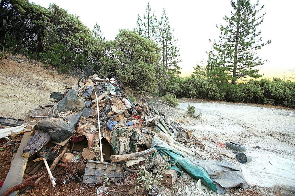 A large pile of refuse pulled from Sugarloaf Mountain homeless encampments waits to be picked up near Coyote Street.