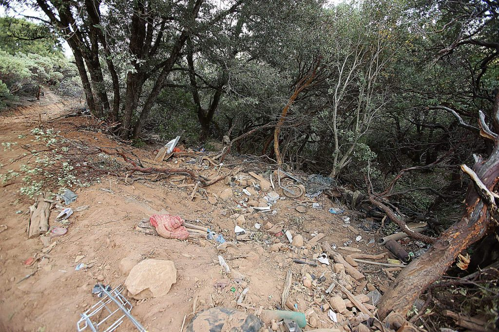Bits of refuse are left behind after a homeless encampment was cleared out on Sugarloaf Mountain in Nevada City.
