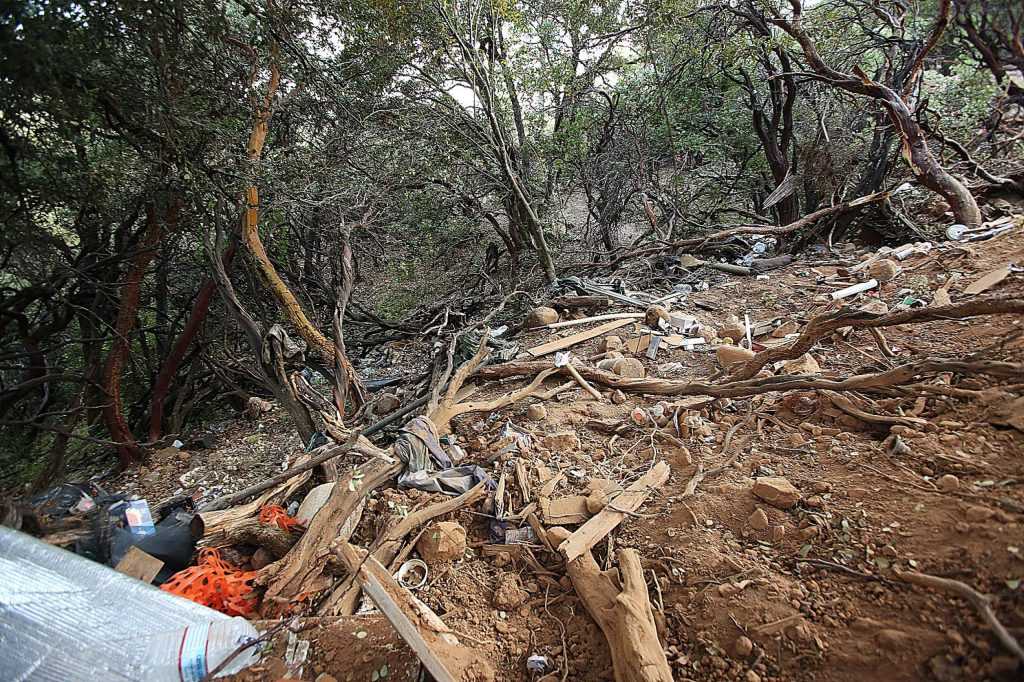 The remnants of a homeless encampment lay under the manzanita and madrone canopy of Sugarloaf Mountain.