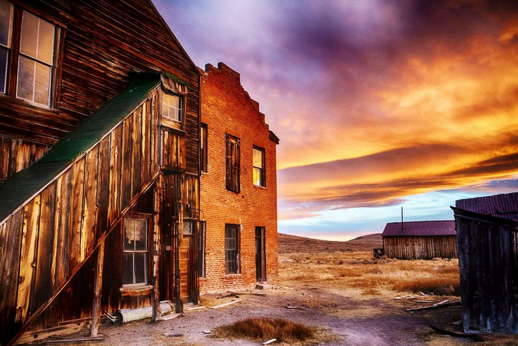 """De Chambeau Hotel, Bodie"" is an illustration of Kathy's photographic artistry, and captures part of the Bodie ghost town (Bodie, California, State Historic Park near the Nevada border) in a spectacular sunset."