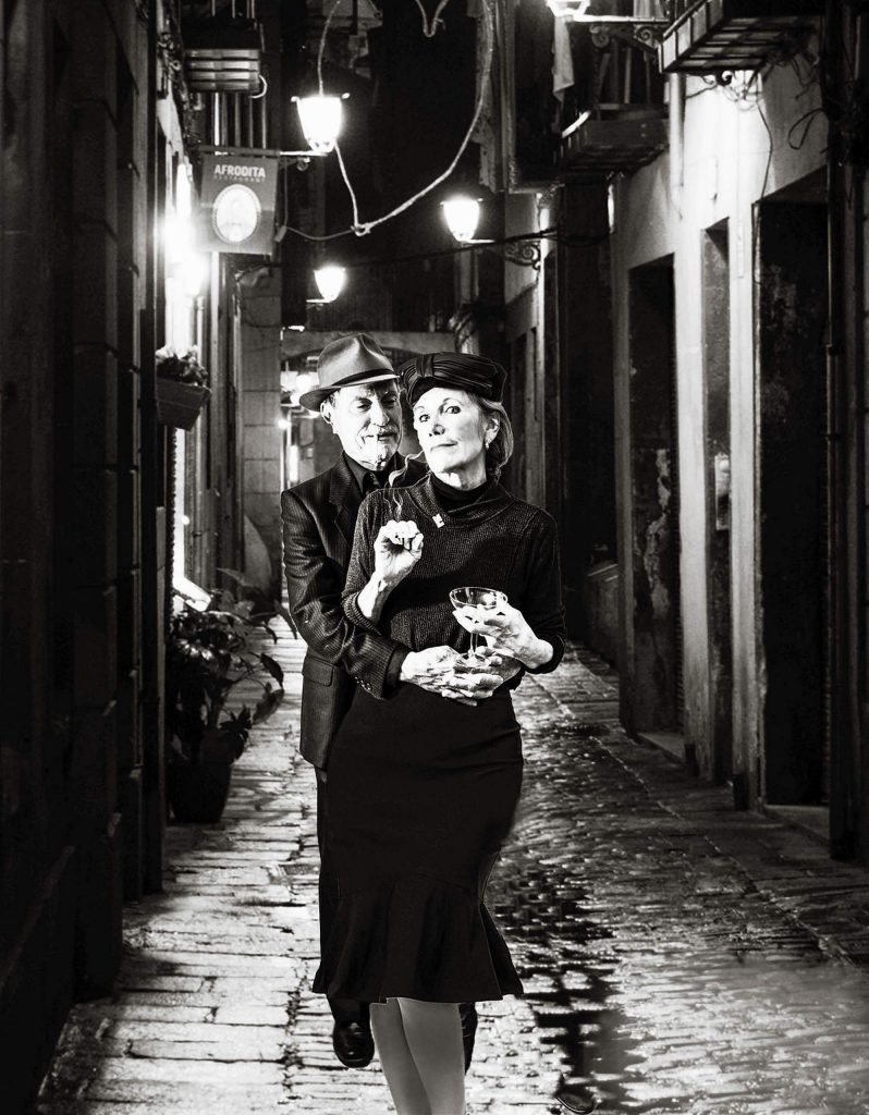 "This example of a noir theme, ""A Night in Barcelona,"" has a sinister couple (taken in Kathy's studio) on the streets of Barcelona, Spain. Staging photos like this is not only intriguing but entertaining."