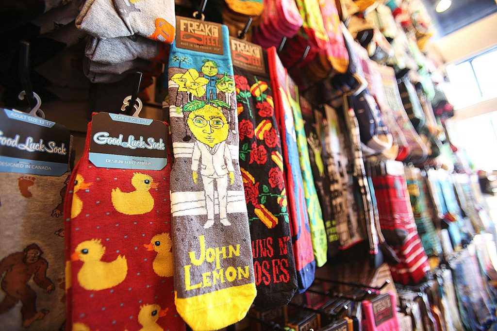 Socks with clever designs and sayings fill the new Mill Street Sock Company in downtown Grass Valley.