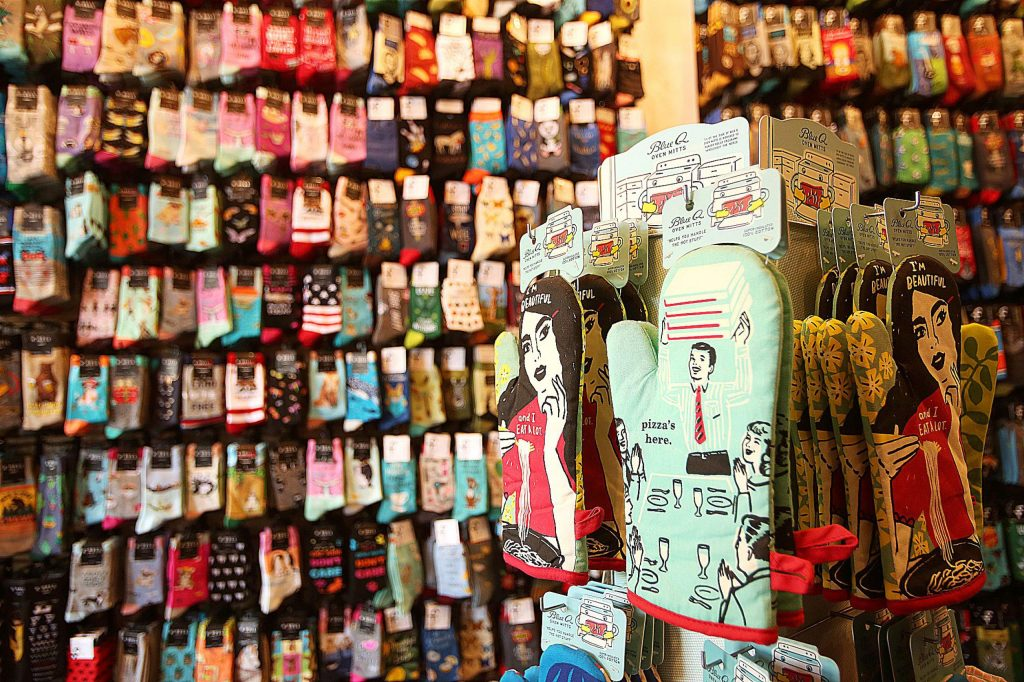 Mill Street Sock Company in downtown Grass Valley has hundreds of multi-colored socks for sale, including some oven mitts.