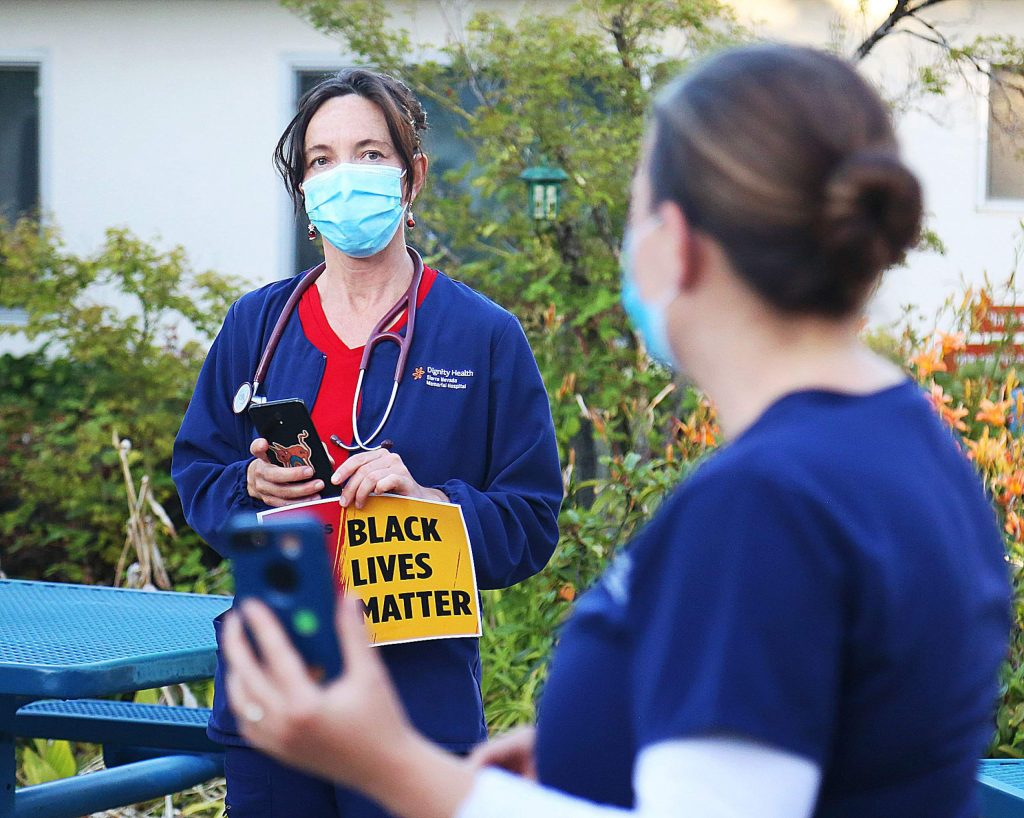 A group of Serra Nevada Memorial Hospital Registered Nurses gathered Wednesday evening at the hospital's healing garden to hold a vigil in honor of George Floyd and other black Americans killed during police confrontations.
