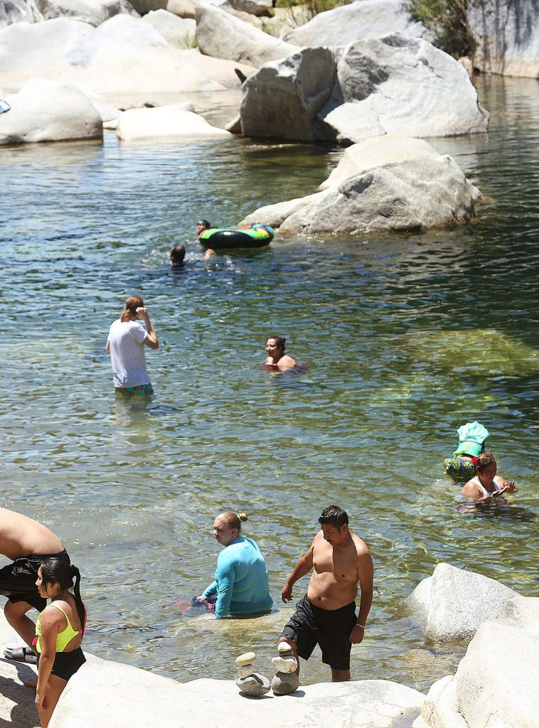 People could be seen using the waters of the South Yuba River Wednesday from the Highway 49 bridge. Temperatures are expected to be in the upper 90s through Saturday, meaning more people will be visiting the river.