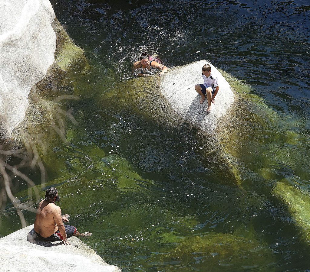A family takes a break on some boulders of the South Yuba River Wednesday afternoon.