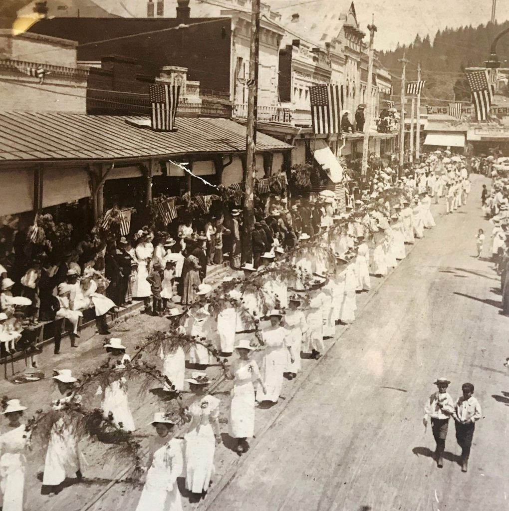 A march of the suffragettes down Mill Street.