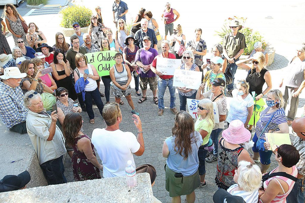 About 60 peaceful protesters gathered outside the Eric Rood Administrative Center in Nevada City in opposition to a proposed ordinance meant to punish coronavirus guideline violators.