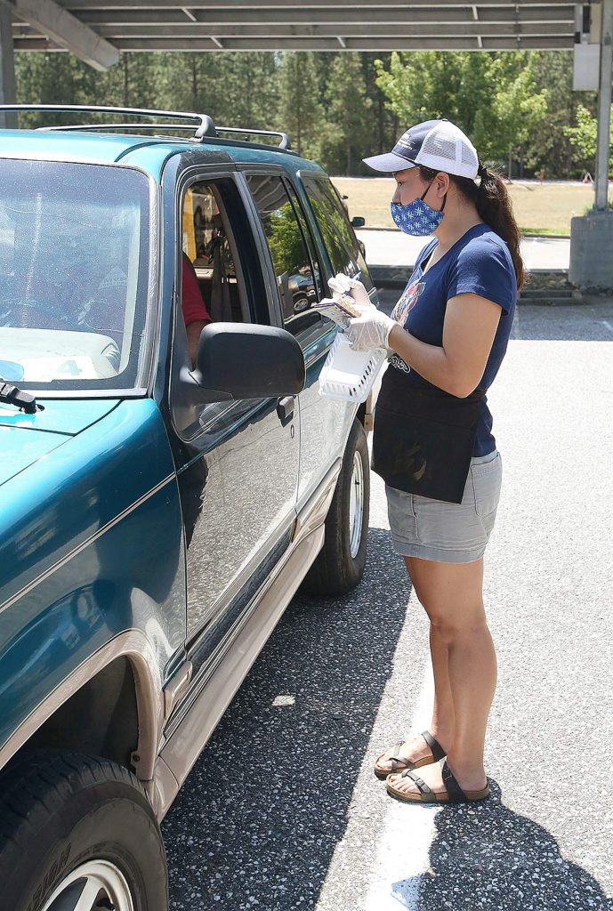 Misa Terrell takes an order for Sierra Savories during Saturday's Car Hop event at the Rood Center.