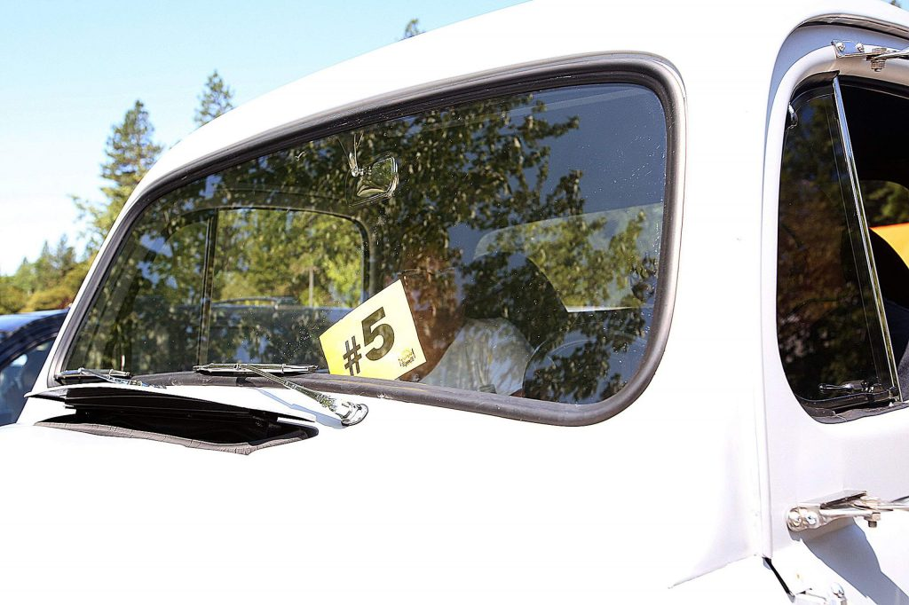 A number is displayed in the windshield of a vehicle signifying that they are waiting to be served from booth #5, Kaliko's Hawaiian Grill, during Saturday's Car Hop temporary food facility event.