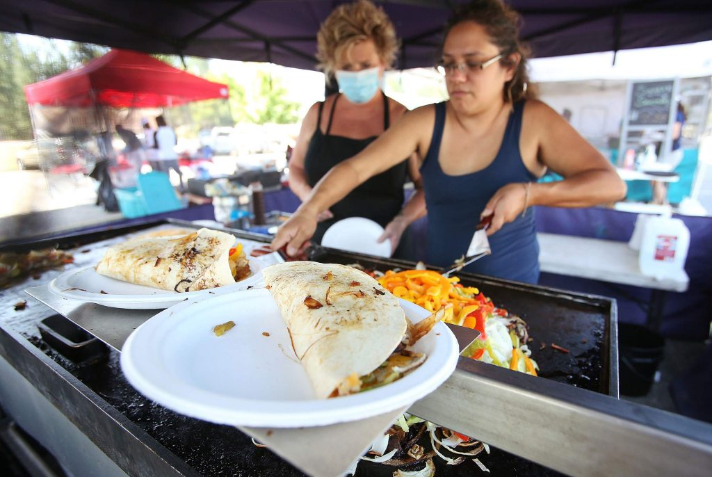 Michelle Milner dishes up some quesadillas from her Sundance Catering Southwest Quesadilla and Sausage booth.