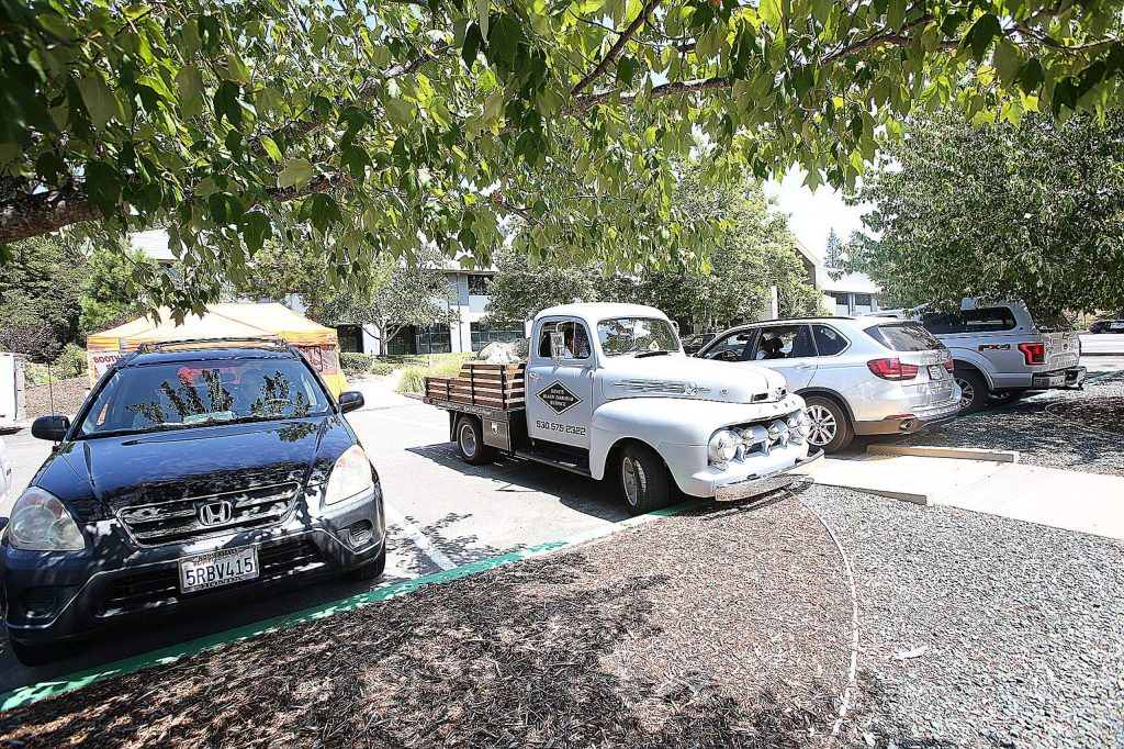 Vehicles begin to fill the parking lot at the Rood Center during Saturday's final Nevada County Car Hop event.
