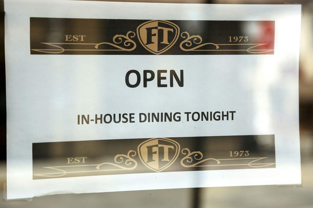 A sign posted to the front doors of Friar Tuck's in Nevada City lets people know that it plans for in-house dining Wednesday evening.