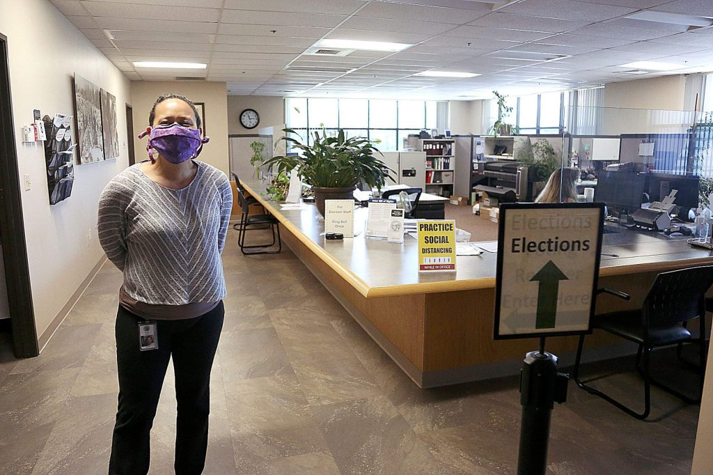 Nevada County Assistant Clerk-Recorder/Registrar of Voters Natalie Adona stands in the county's elections department, where she and other staff are available to help people file for a multitude of different political seats that will be up for grabs in the November election.