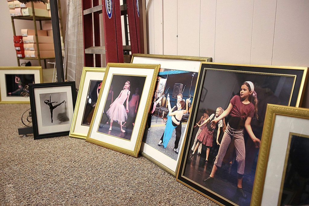Photos of local dancers once on the walls of Escott Place, have now been taken down due to the store's closure.