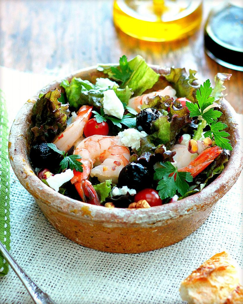 This salad has summer written all over it. Shrimp, feta and olives are the star ingredients, mingling with sweet corn, juicy tomatoes and plenty of garden greens. It's beautiful when presented in a large serving bowl or arranged in individual serving bowls.