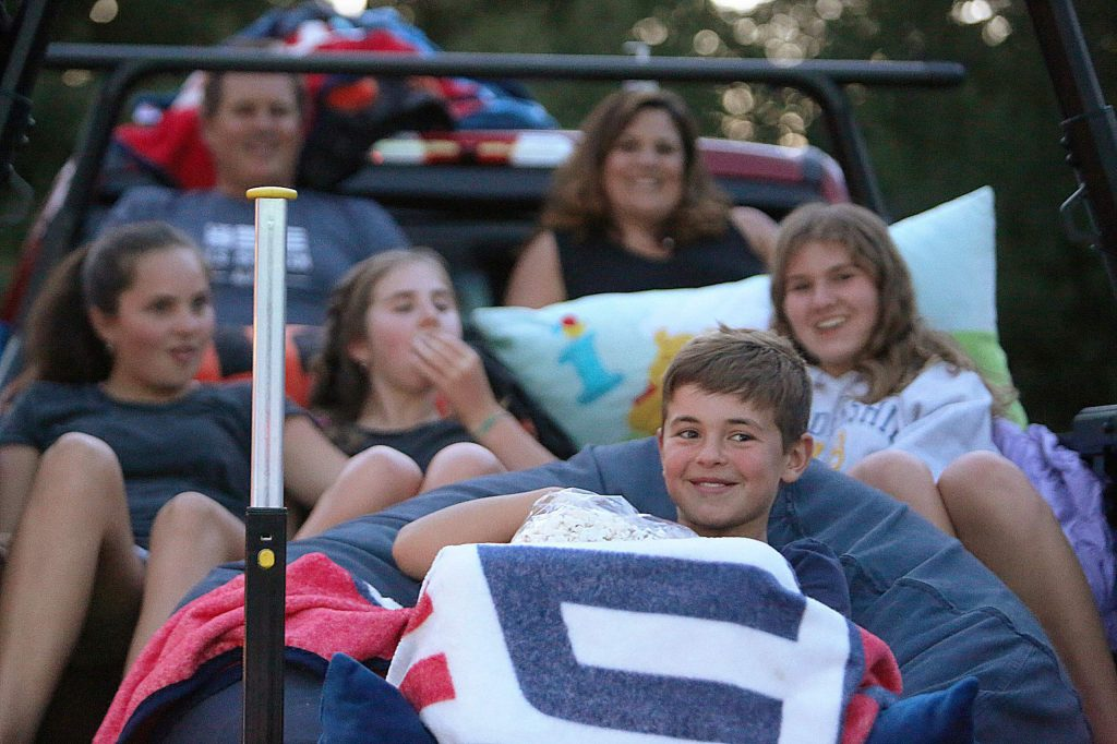 Members of the Barber Family enjoy a bag of Onyx Theatre popcorn while waiting for Saturday night's movie to start. Movies start at sunset and guests are asked to arrive no later that 8:30 p.m.