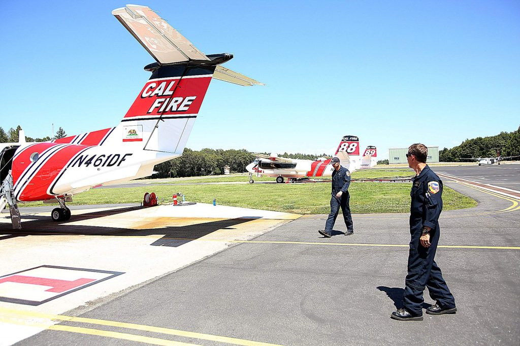 Cal Fire Air Tactical Ground Support Captain Sean Ryan and Battalion Chief David Krussow walk towards the Cal Fire Beechcraft King Air airplane that they have been training in for the past two weeks at the Grass Valley Interagency Air Attack Base.