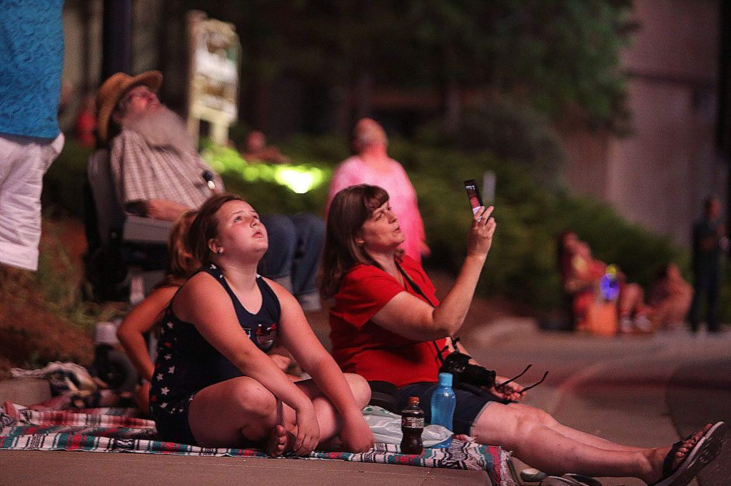 Spectators from nearby apartment complexes lined Dorsey Drive near the site of Saturday's Fourth of July fireworks display in Grass Valley.