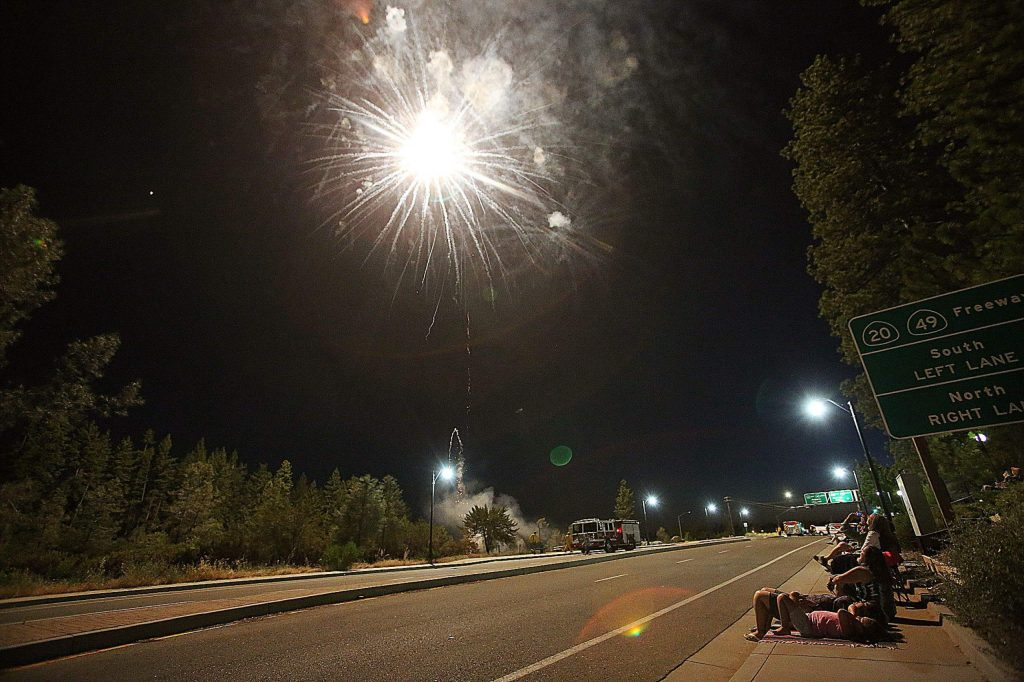 A large flash of light explodes over the Dorsey interchange where Saturday's stay at home Fourth of July fireworks display took place. Many spoke of being in favor of the new location of the fireworks which occurred due to the fairgrounds being closed.