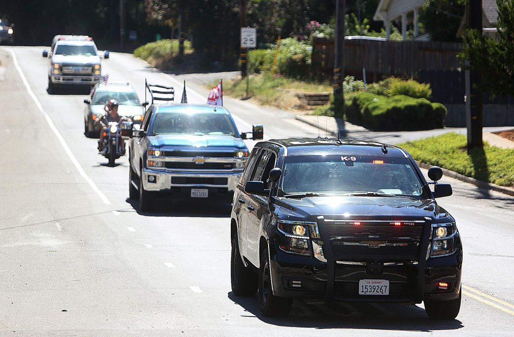 Police, fire, and a few vehicles from the community, parade through Grass Valley along Empire Street during the more than two hour stay at home parade that took place along the streets of Grass Valley and Nevada City.