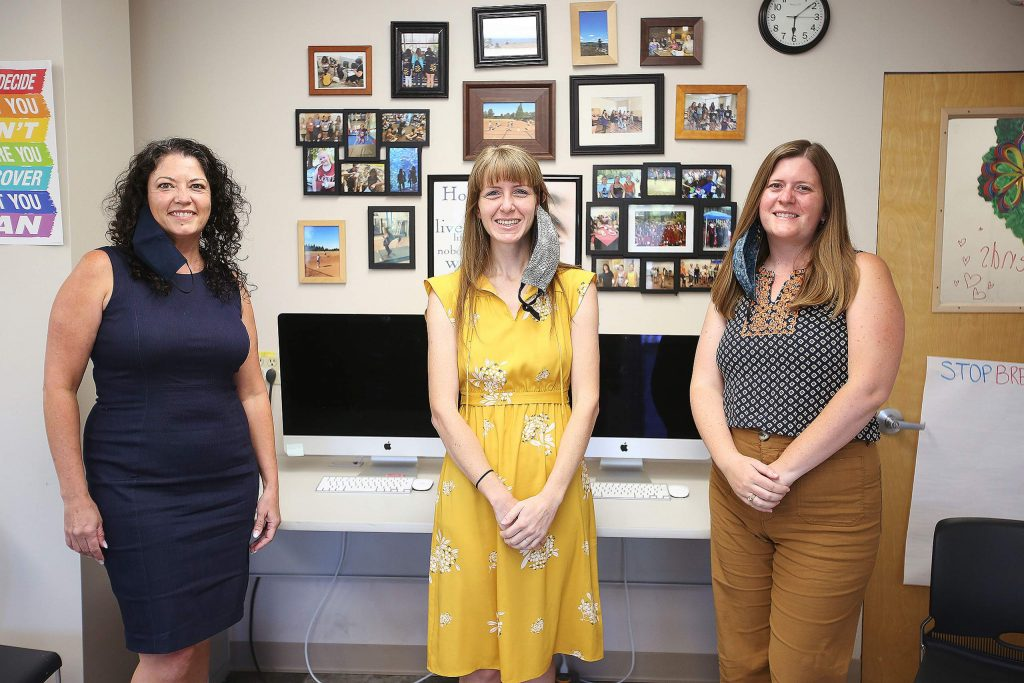 Jennifer Litton Singer, executive director of the Friendship Club, left, stands with NEO founders Halli Ellis-Edwards and Lynn Skrukrud Wednesday at the Litton Building where the two organizations will be sharing space.