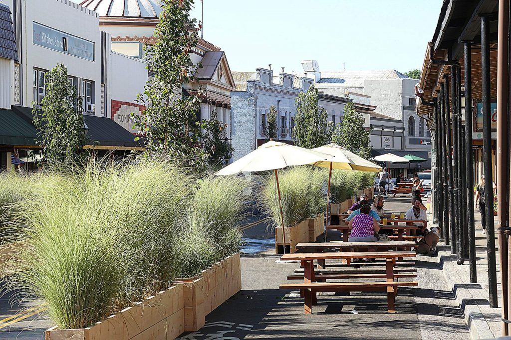 Planter boxes and shade umbrellas have been brought to the portion of Mill Street between Main and Bank streets that has been blocked to accommodate foot traffic only. Some business owners were upset that they weren't informed about the changes.