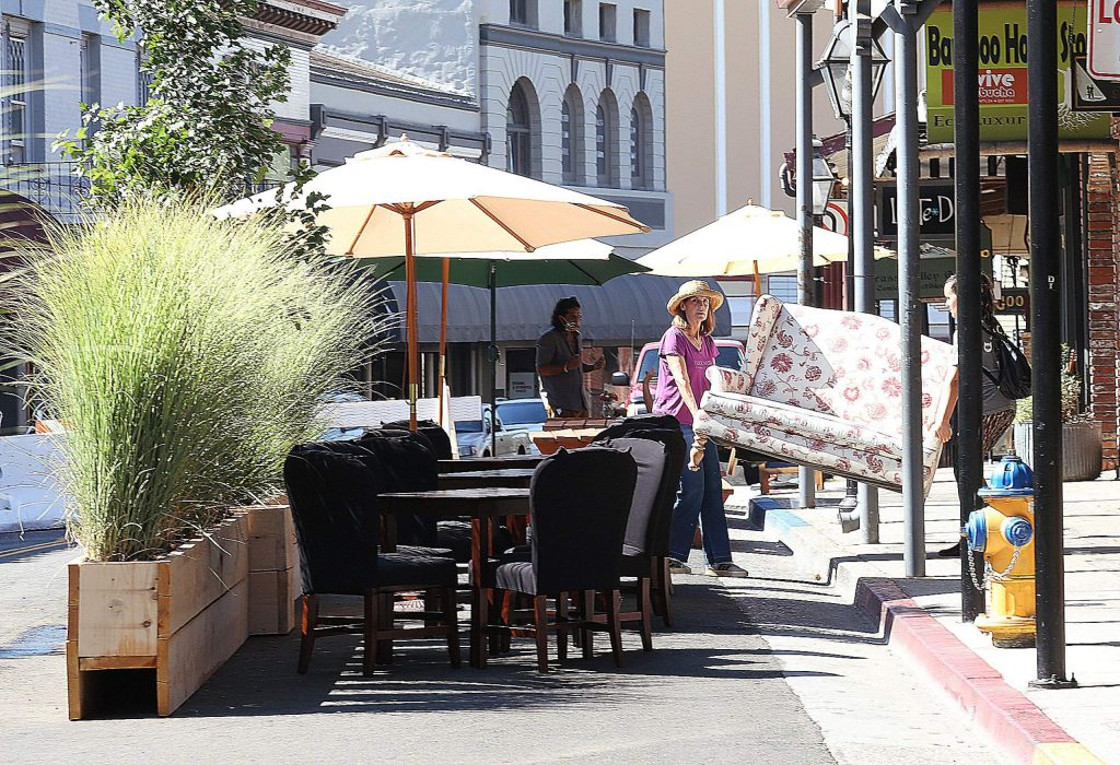 Lounge seating from Lucchesi Vineyards is pulled out to the streets where traffic has been diverted to allow for a walkable Mill Street between Main and Bank streets.