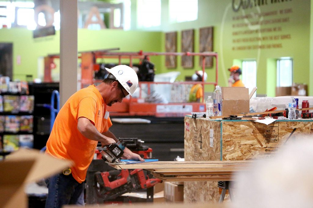 Construction crews continue to work away on the interior details of the new Holiday Market nearing completion near Highway 49 and Combie Road.