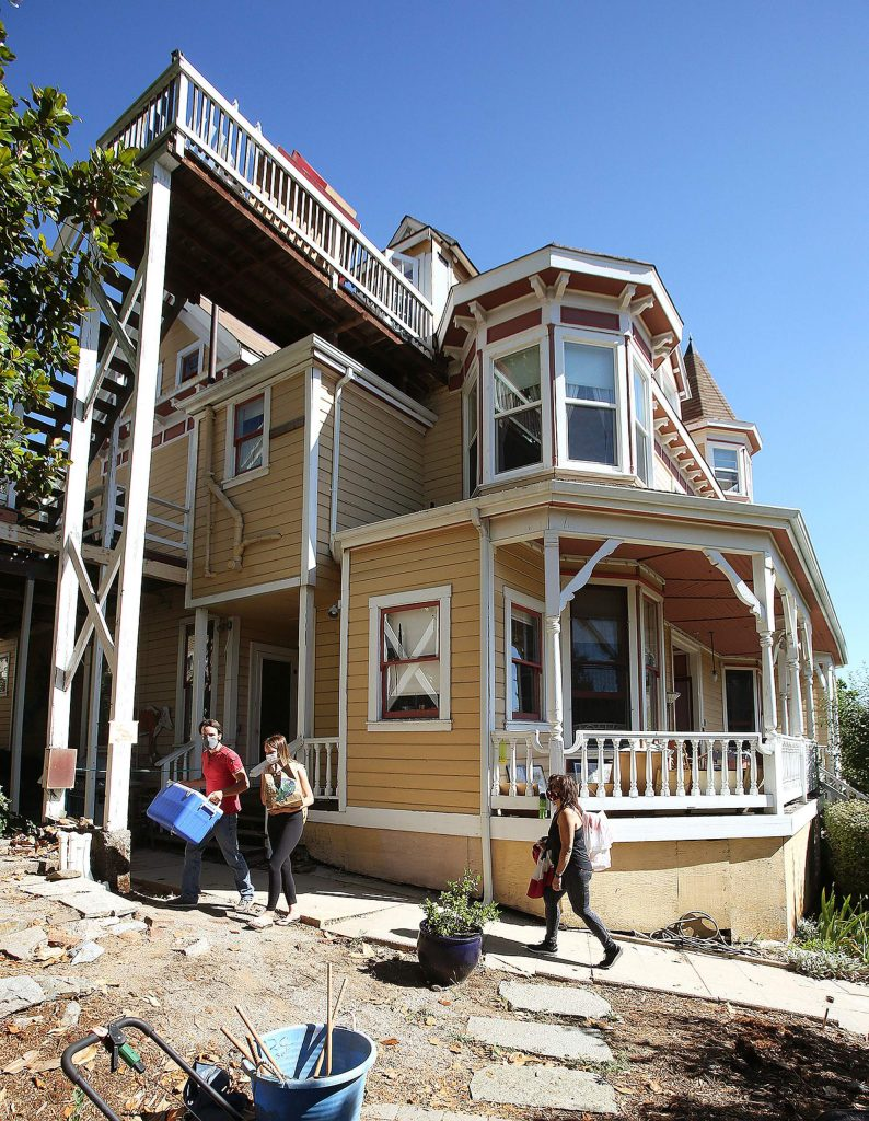 Estate sale seekers find items at the Swan Levine house Saturday morning on the 300 block of Church Street in Grass Valley.