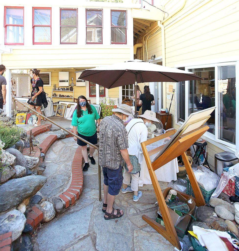 People peruse the items of the Swan Levine House for sale during Saturday's estate sale.