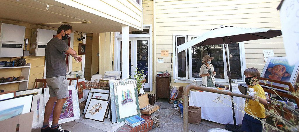 People search through the items of the Swan Levine House for sale during Saturday's estate sale.