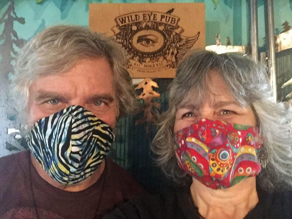 Wild Eye Pub owners Dave Kuczora and Beth Moore will knock a dollar off the price of a beverage for patrons wearing masks.