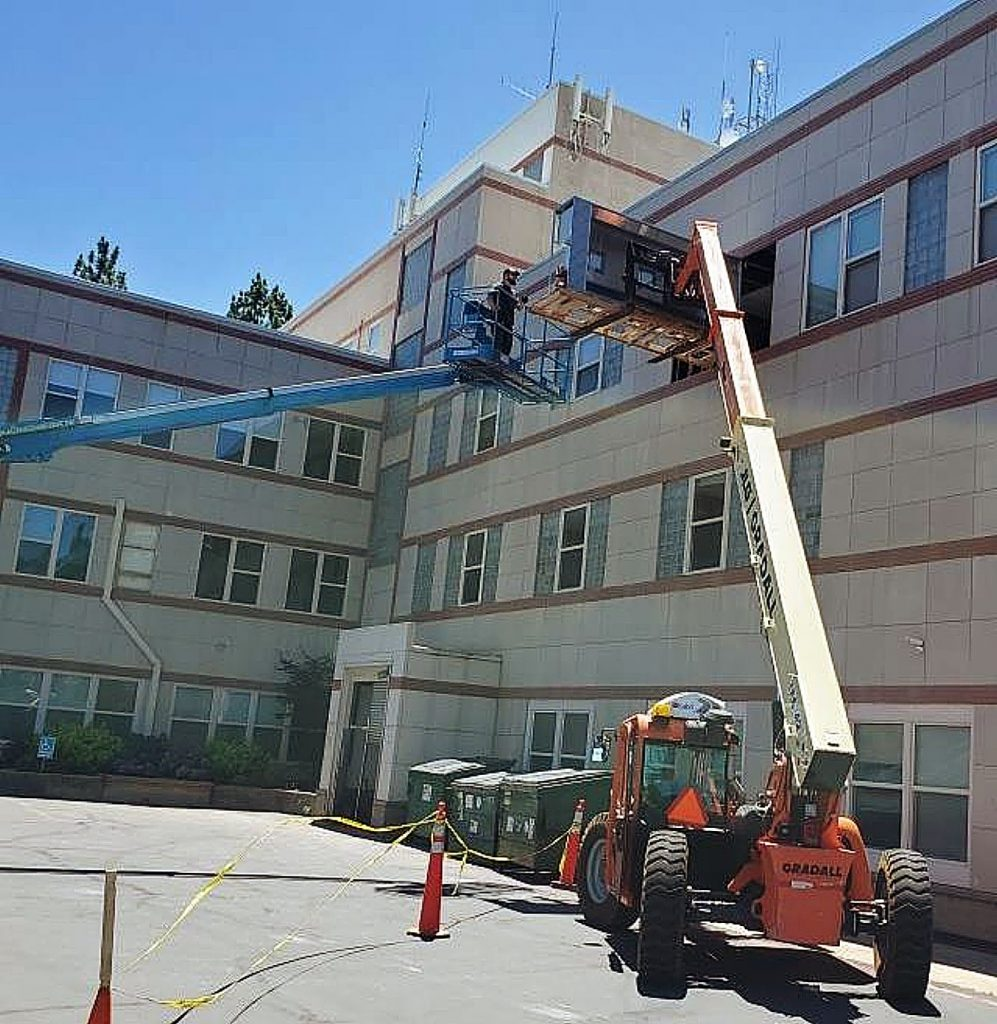Local contractor Dan Thomassen used two cranes to install this 1,100-pound oven hood at the Friendship Club headquarters.